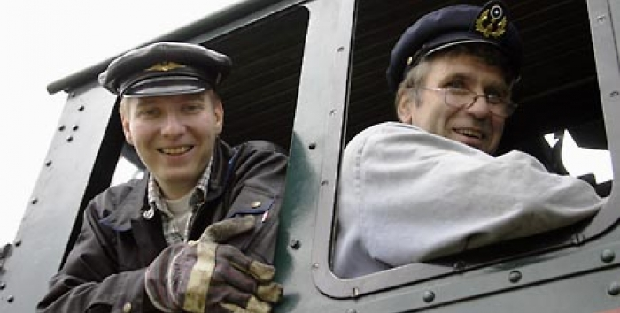 Engineer and fireman in the locomotive cabin.