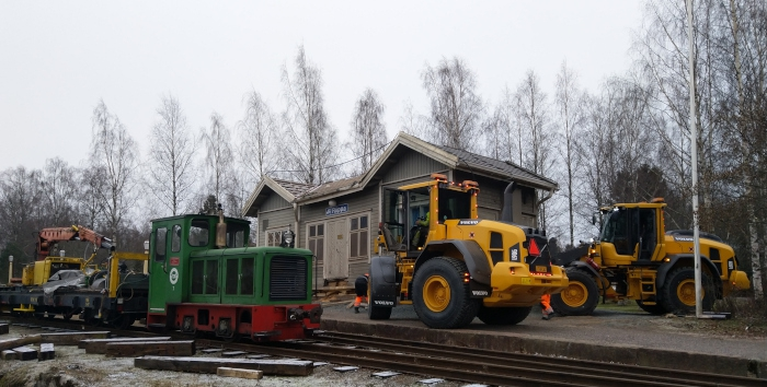 Station building and orange tractors.